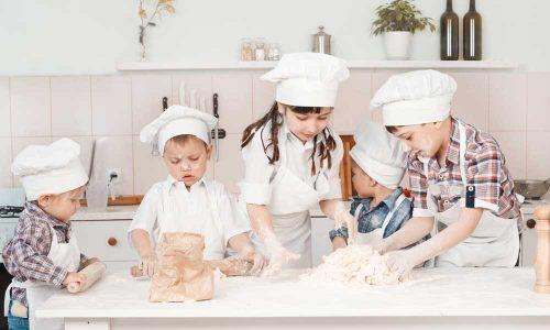 happy-little-chefs-preparing-dough-in-the-kitchen